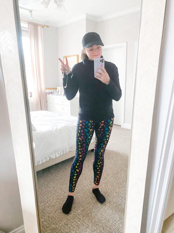 Black Cubs Hat, Lululemon Scuba Turtleneck, Terez Rainbow Leopard Foil Leggings