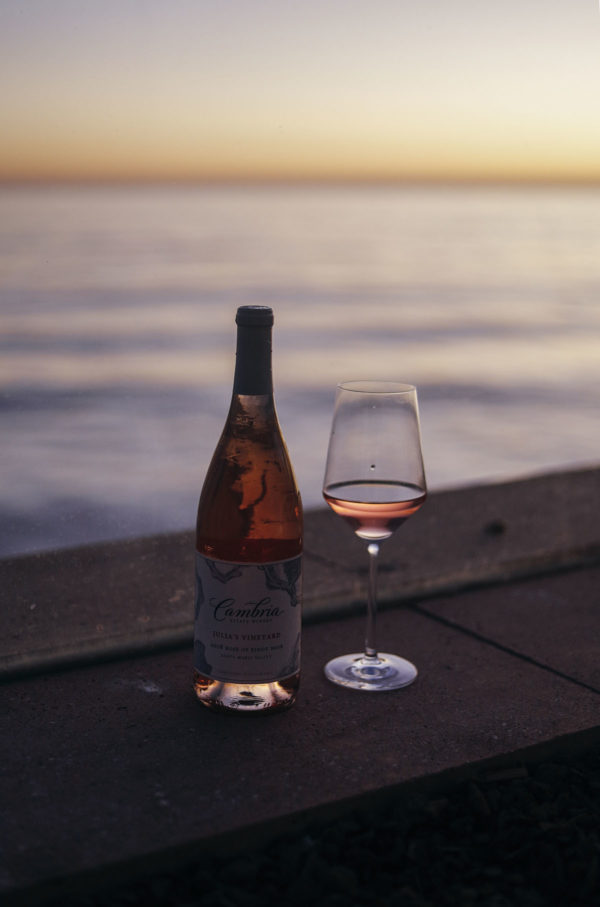 Cambria Wine's Julia's Vineyard Rose of Pinot Noir on the beach at sunset at Coral Casino in Santa Barbara, California.