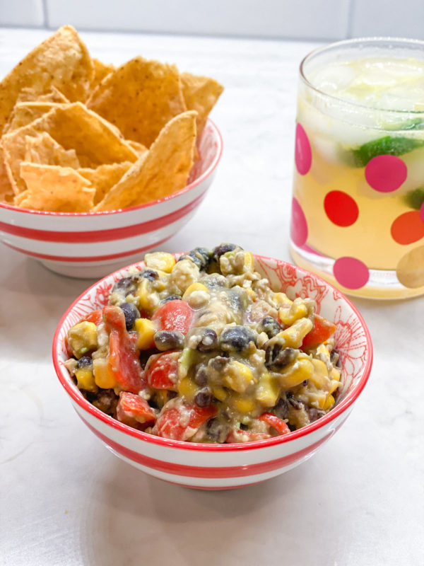 Corn, black bean, and feta dip recipe with chips.