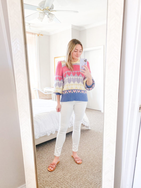 LoveShackFancy Hearts Sweater, White Jeans, Marc Fisher Pink Suede Studded Slides