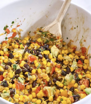 Corn and black bean salsa dip for chips with avocado and tomato. Pretty healthy, very easy, and full of flavor!