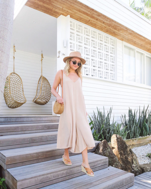 Fashion blogger wearing tan wide leg jumpsuit at Bask & Stow in Byron Bay Australia