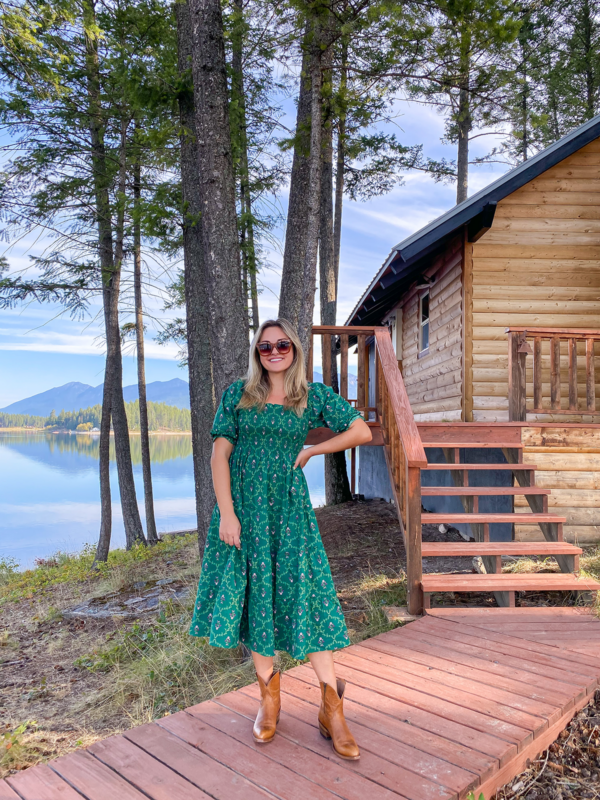 Top lifestyle blogger Jessica Sturdy wearing a Hill House Nap Dress in the Green Trellis Print with Alvies Cowboy Boots for Women at a VRBO cabin in Montana.