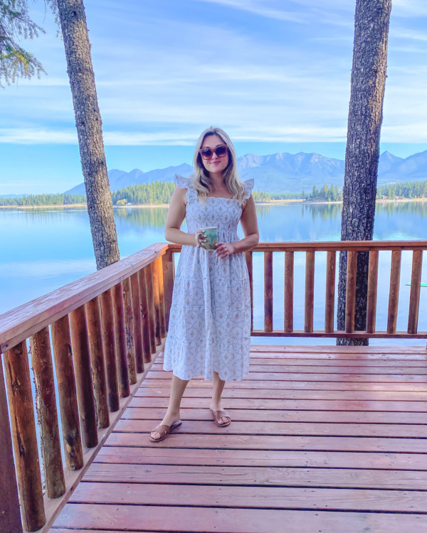 Fashion and travel blogger Jessica Sturdy wearing a Hill House Ellie Nap Dress in Pastel Trellis at a VRBO Lakefront Cabin in Montana
